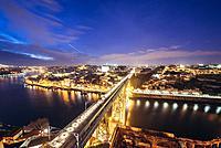 Evening in Porto city, Portugal. Aerial view from Serra do Pilar viewpoint in Vila Nova de Gaia city with Dom Luis I Bridge over Douro River.
