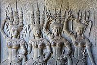 Aspara sculptures in bas-relief on the wall, in Angkor Wat, Siem Reap, Cambodia.
