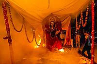 The figure of Holika burning a top a pyre during the Holika Dahan in Mathura on Purnima (full moon) the night before Holi; Mathura, Uttar Pradesh, Ind...