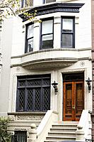 New York City, Manhattan, Upper West Side. Close Up of a Brownstone Townhouse Entry and Second Floor Window.