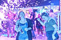 happy friends enjoying foam party at music festival. North American ethnicity. In holiday destination Hersonissos, Crete, Greece