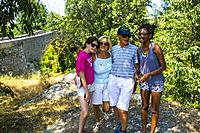 Grandparents on a family vacation in the south of france with grandchildren. Caucasian grandparents taking photos with their teenager granddaughters: ...