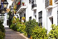 Typical street with flowers, Benalmadena. Málaga province, Costa del Sol, Andalusia. Southern Spain Europe.