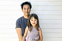 Asian father with his five year old daughter.