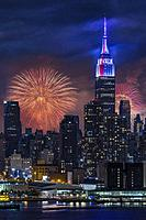 NYC Fourth Of July Fireworks - New York City skyline with the Macy´s Spectacular 4th of July Fireworks Celebration Show as a backdrop to midtown Manha...