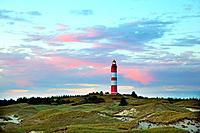 Lighthouse of the island of Amrum with illuminated evening clouds, Northfrisian Islands, Schleswig-Holstein, Germany, Europe.