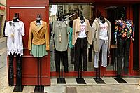 An outdoor display of women's clothing at a shop in Pezenas, France.