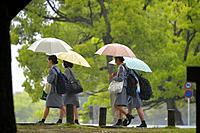 People with umbrellas walking in downtown Hiroshima,Hiroshima Prefecture, Japan,Asia.