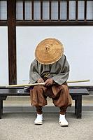 Traditionally dressed man in Dejima in the port of Nagasaki, Kyushu, Japan, Asia.