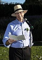 A man, 63, reads a speech at an outdoor wedding in West Vancouver, BC, Canada.