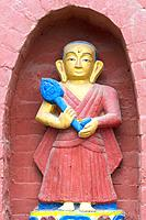 Statue decorating the base of the Bumisparsha mudra Buddha Statue, Swayambunath or Monkey Temple, Kathmandu, Nepal, Asia.