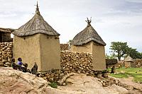 Mali. Dogon Country. Begnimato village. Barns erected with wood and adobe. Children playing.