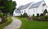 Jelling church with graveyard and the stones, Jutland, Danmark.