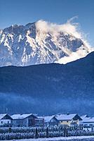 Austria, Tyrol, Stams, village view with Miemingergebirge Mountains, winter.