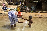 Mother washing her son in river Niger, in a little bozo ethnic group village opposite to Segou City. Mali