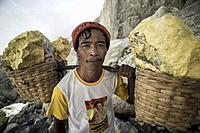 Portrait of one of the miner carrying sulfur rocks at the Kawah Ijen Volcano, East Java, Indonesia.