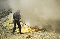 A miner extracting sulfur from the Kawah Ijen Volcano crater, East Java, Indonesia.