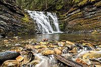 Water flows over rocks at lower Sweetcreek Falls, near Metaline, Washington.