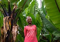 Dorze woman in the middle of enset false bananas trees, Gamo Gofa Zone, Gamole, Ethiopia.