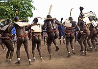Bodi tribe fat men dancing during Kael ceremony, Omo valley, Hana Mursi, Ethiopia.