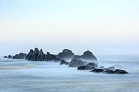 Seal Rock beach and rocks at dawn, Seal Rock State Recreation Site, Seal Rock, Oregon, USA.