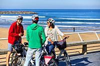 Group of tourists and guide making a bicycle tour through the city, Zurriola Beach, Gros, Donostia, San Sebastian, Gipuzkoa, Basque Country, Spain, Eu...