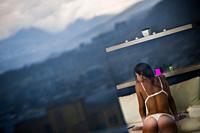 A Colombian webcam model, known as Caro Ortiz, performs a sensual live show during a webcam video broadcast from her apartment in Medellín, Colombia, ...