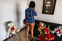A Colombian webcam model, known as Daniela Hernandez, arranges the show scenario by phone, before broadcasting the live act from her apartment in Mede...