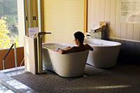 Japanese man relaxing in bath or onsen in Takayama, Japan, Asia.