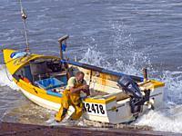 Crab fishermenlanding boat at Sherringham Norfolk.