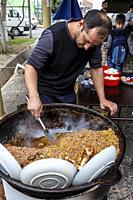 A Man Cooks Rice For PLOV (The National Dish) At The Central Asian Plov Centre, Tashkent, Uzbekistan.