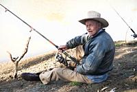 "A local character fishing in the Barcoo, a western Queensland river flowing towards Lake Eyre in central Australia. """"Dickie' McCulkin, 70, lived and ..."