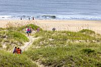 Avon, Outer Banks, North Carolina, USA. A Family Making its Way over the Dunes to the Beach.