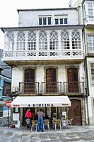 Bar at a traditional Galician architecture building with glass gallery at Viveiro, Lugo Province, Galicia, Spain, Europe.