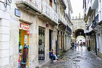 Maria Sarmiento street with the Gate of Carlos V in background in the Old Town of Viveiro, Lugo province, Galicia, Spain, Europe.