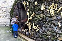 Wax body parts votive offerings at the Lourdes Grotto in the Convent of the Concepcionistas, a 1925 scale reproduction of the French grotto. Viveiro, ...