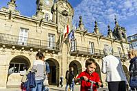 People by the Baroque 18th c. Town Hall building at Praza Maior square in Lugo, Galicia, Spain, Europe.