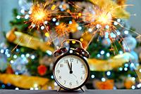 Happy New Year concept with Sparkler Fireworks and clock.