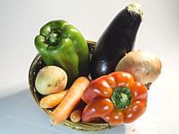 Basket of vegetables on white bakcground.