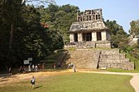 Tourists walking around The Temple Of The Sun-Templo Del Sol in Mayan Archaeological Site Palenque, Chiapas State, Mexico, Central America