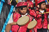 Itoman, Okinawa, Japan: children playing Eisa music during the O-tsunahiki Festival