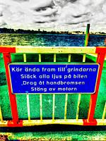 Information sign in Swedish for drivers on ferry saying ´drive all the way to the gate, turn off all the vehicle´s lights, engage the handbrake, turn ...