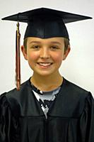 6th Grade Boy in Cap and Gown, Wellsville, New York, USA.