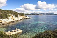 Quiet family morning at the Marina of Cala Dragunara. Alghero, Sardinia. Italy.