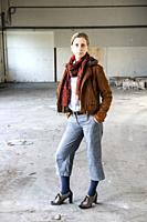Tilburg, Netherlands. Portrait gender biased woman, wearing men´s fashion inside an abandoned industrial environment. Wearing opposite gender´s wardro...