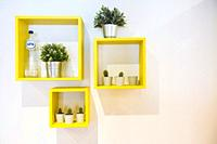 Tilburg, Netherlands. Interior decoration cubes on a fashion store wall, giving a domestic ambiance and support sales.
