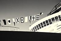 View of a cruise ship displaying maritime signal flags