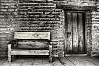 Weathered wooden bench in a mission in San Diego, California