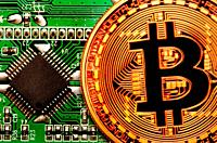 Bitcoin cryptocurrency / payment system (Copper Bitcoin Commemorative Round . 999 bullion) Electronic currency. Circuit board with chip.