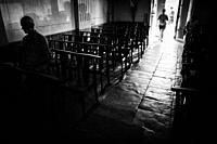 Silhouettes of unrecognizable people entering church. Corte, Corsica, France.